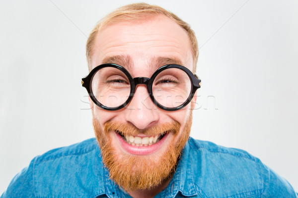 Funny cheerful bearded man in round glasses Stock photo © deandrobot