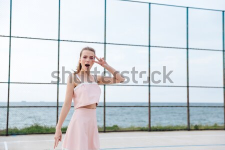 Alluring curly woman in pink lace lingerie  enjoying the view Stock photo © deandrobot
