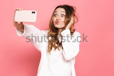 Attractive woman showing stop sign with palm Stock photo © deandrobot