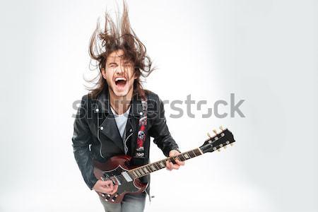 Crazy молодым человеком голову играет электрической гитаре белый Сток-фото © deandrobot