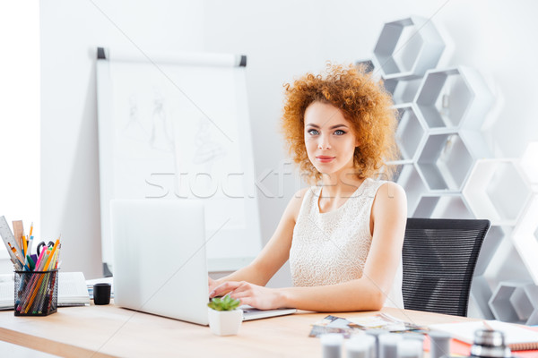 Beautiful confident woman fashion designer using laptop in office Stock photo © deandrobot