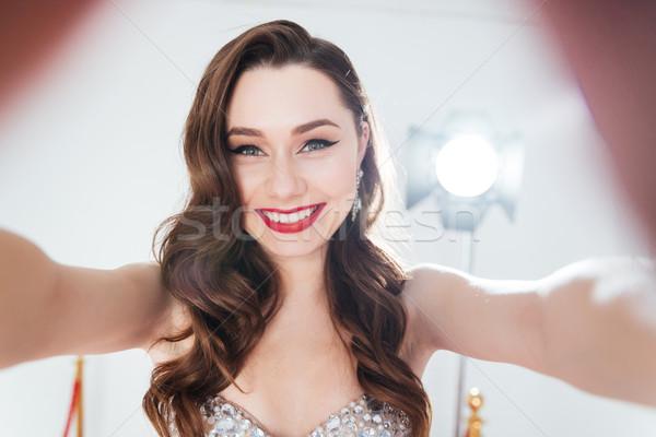 Charming woman making selfie photo  Stock photo © deandrobot