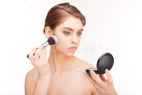 Beauty portrait of attractive young woman using powder Stock photo © deandrobot