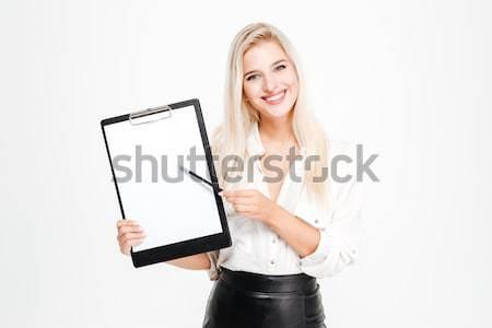 женщину указывая пальца портативного компьютера экране смеясь Сток-фото © deandrobot