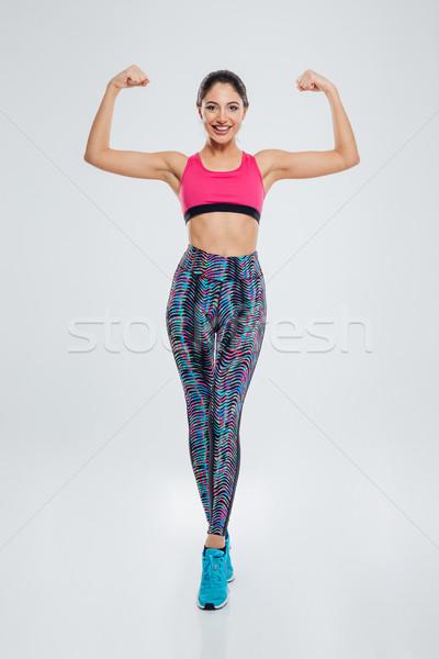 Фитнес-женщины бицепс портрет изолированный Сток-фото © deandrobot