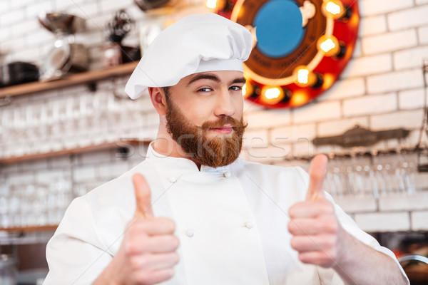 Gülen çekici şef pişirmek Stok fotoğraf © deandrobot