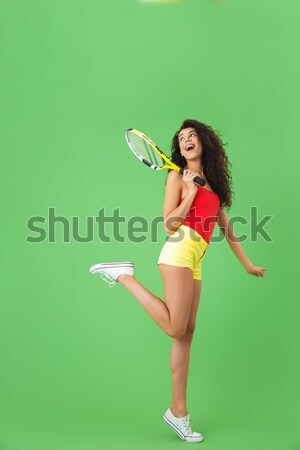 Full length of woman in blue swimwear holding water gun Stock photo © deandrobot