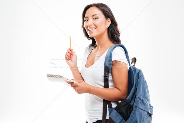 Alegre Asia muchacha adolescente idea cuaderno Foto stock © deandrobot