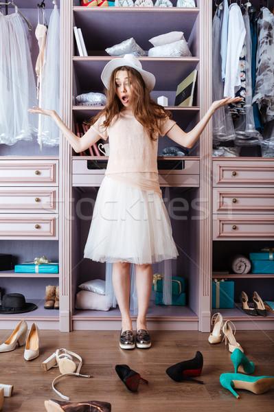 Fille chaussures armoire jeunes pensive Photo stock © deandrobot
