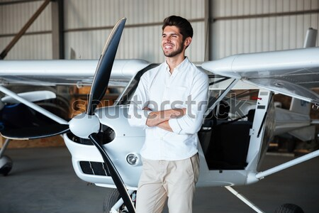 Man pilot sitting in small airplane Stock photo © deandrobot