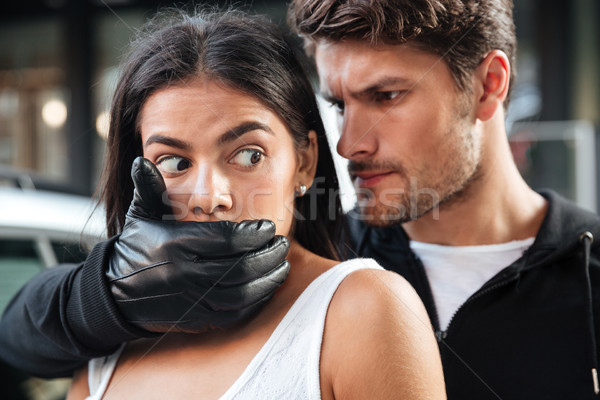 Man criminal in gloves grabbed scared woman and covered mouth Stock photo © deandrobot