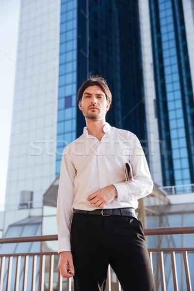 Fresco empresario ciudad mirando cámara buena Foto stock © deandrobot