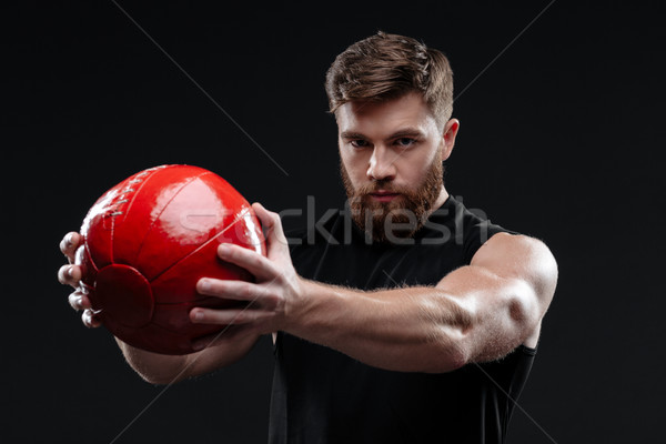 Young trainer with ball Stock photo © deandrobot