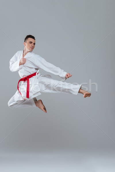 Sportsman in kimono practice in karate while jumping Stock photo © deandrobot