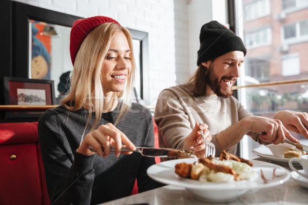 Side view of couple eating in cafe Stock photo © deandrobot