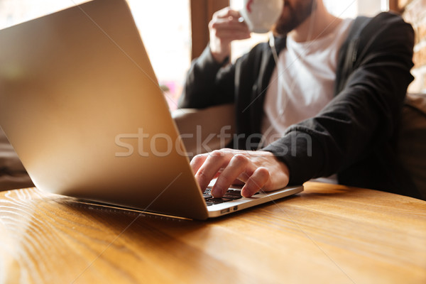 Cropped image of man in cafe near the window Stock photo © deandrobot