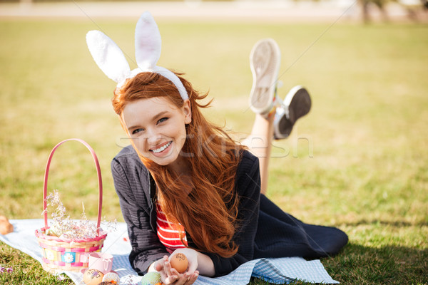 Portrait of a smiling happy red head girl Stock photo © deandrobot