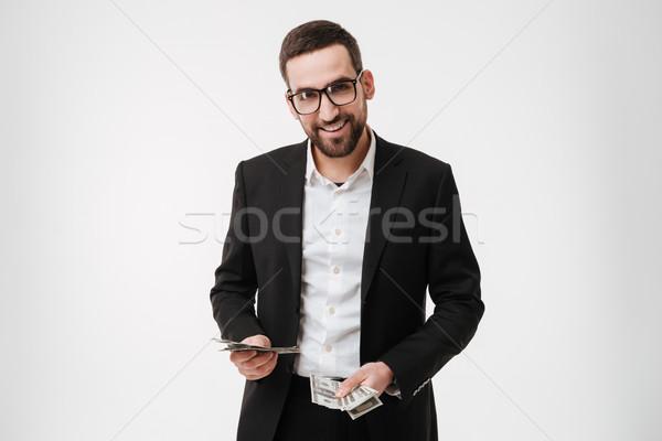 Sonriendo jóvenes barbado empresario dinero Foto stock © deandrobot