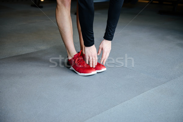Cropped image of Fitness man warming up Stock photo © deandrobot
