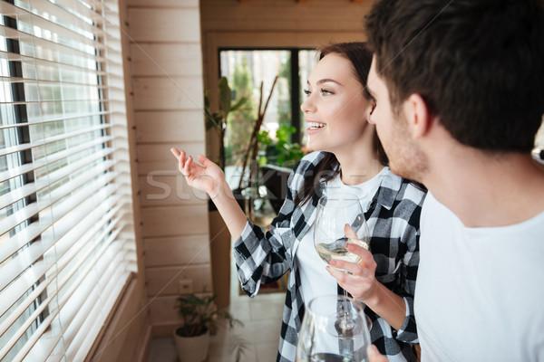 говорить женщину сидят гостиной шампанского Сток-фото © deandrobot