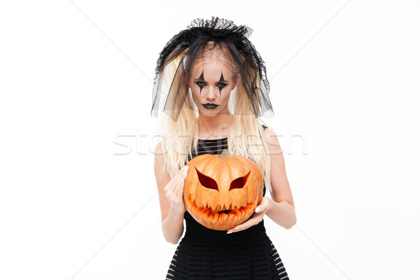 Terrible blonde woman dressed in black widow costume Stock photo © deandrobot