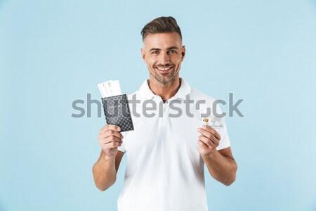 Mosolyog fiatalember megold kocka kép fehér Stock fotó © deandrobot