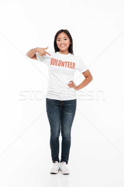 Retrato sorridente jovem asiático mulher voluntário Foto stock © deandrobot
