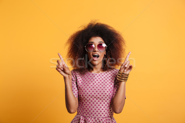 Close-up portrait of retro stylish amazed african wooman in sung Stock photo © deandrobot