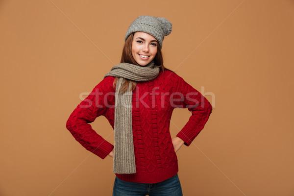 Dziewczyna czerwony trykotowy sweter wełniany Zdjęcia stock © deandrobot