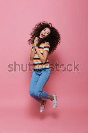 Full length side view image of happy brunette woman rejoice Stock photo © deandrobot