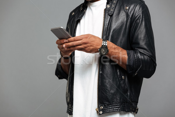 Imagen afro americano hombre chaqueta de cuero Foto stock © deandrobot