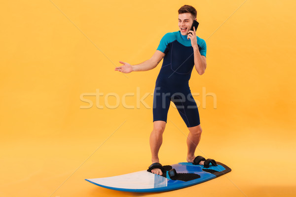 Kép meglepődött boldog szörfös szörfdeszka beszél Stock fotó © deandrobot
