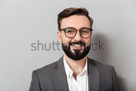 Close up portrait of caucasian unshaved man in eyeglasses lookin Stock photo © deandrobot