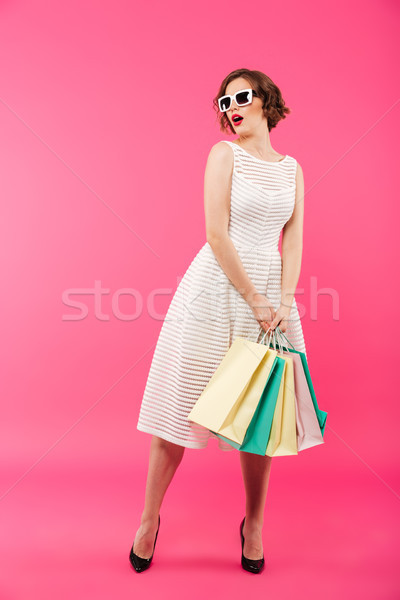Full length portrait of a surprised girl dressed in dress Stock photo © deandrobot