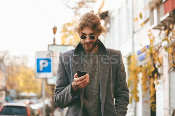 肖像 笑みを浮かべて あごひげを生やした 男 イヤホン 着用 ストックフォト © deandrobot
