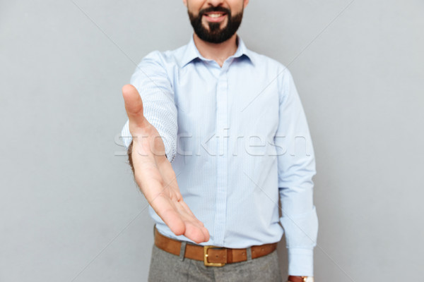 Cropped image of smiling bearded man in business clothes Stock photo © deandrobot