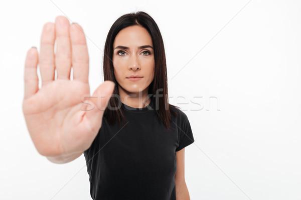 Portrait of a confident woman showing stop gesture Stock photo © deandrobot