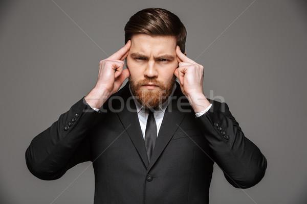 портрет концентрированный молодые бизнесмен костюм пальцы Сток-фото © deandrobot