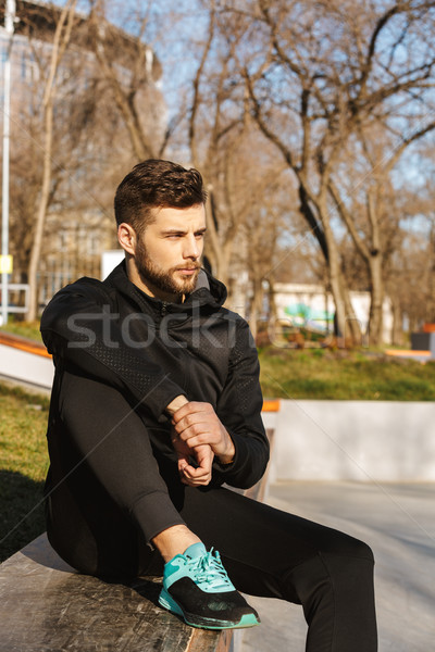 Portrait of a tired young sportsman in earphones Stock photo © deandrobot