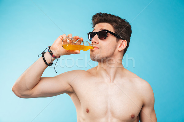 Close up portrait of a shirtless young man in sunglasses Stock photo © deandrobot