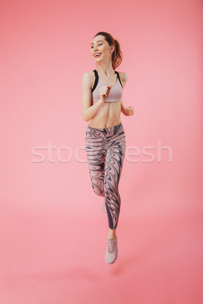 Happy young fitness sports woman running isolated Stock photo © deandrobot