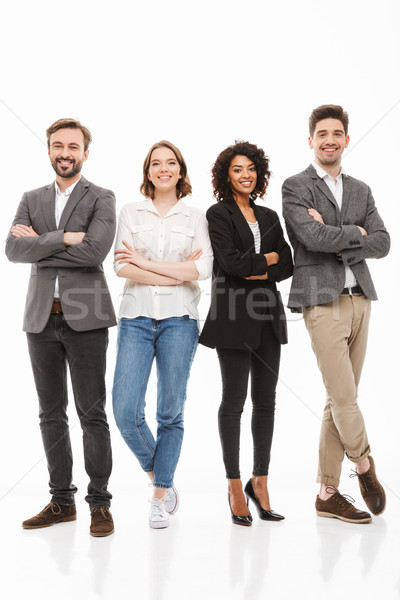 Full length portrait of a group of multiracial business people Stock photo © deandrobot