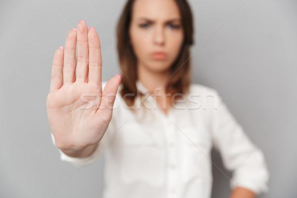 Portrait sérieux jeunes femme d'affaires arrêter Photo stock © deandrobot
