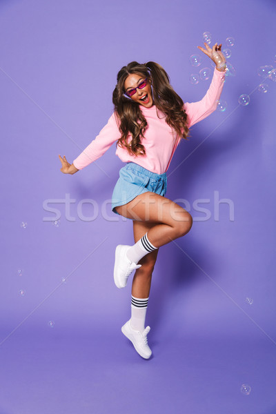 Full length portrait of trendy beautiful girl with two ponytails Stock photo © deandrobot