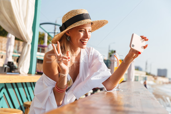 Stock photo: Attractive young girl in summer hat and swimwear