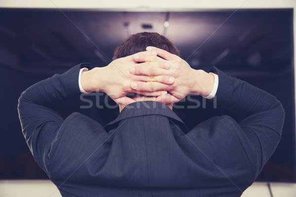 вид сзади портрет бизнесмен Постоянный оружия за Сток-фото © deandrobot