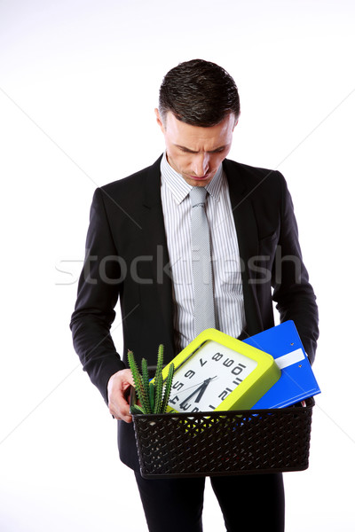 You are fired! Businessman hold box with personal belongings on gray background Stock photo © deandrobot