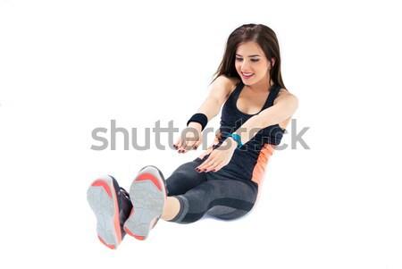 Stock photo: Sporty woman doing abdominal exercises
