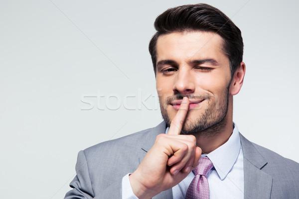 Empresário indicação dedo lábios silêncio Foto stock © deandrobot