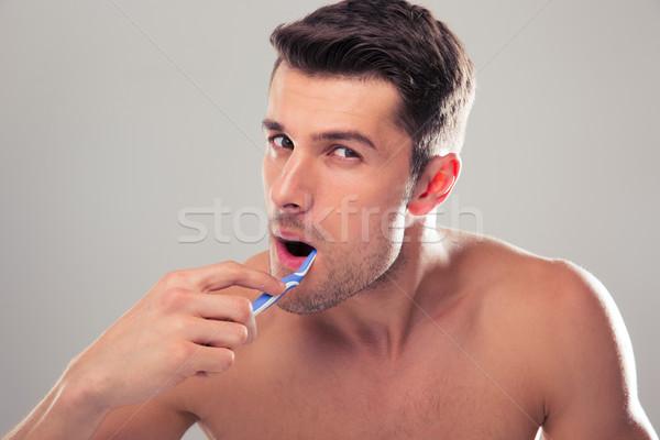 Portret knappe man grijs gelukkig jonge Stockfoto © deandrobot